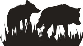 black silhouettes of wolves in the grass