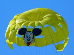 yellow parachute with a mickey mouse
