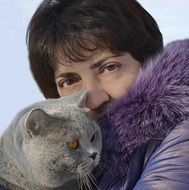 portrait of a woman with british blue cat