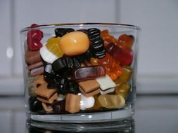 multi-colored candies in a glass cup