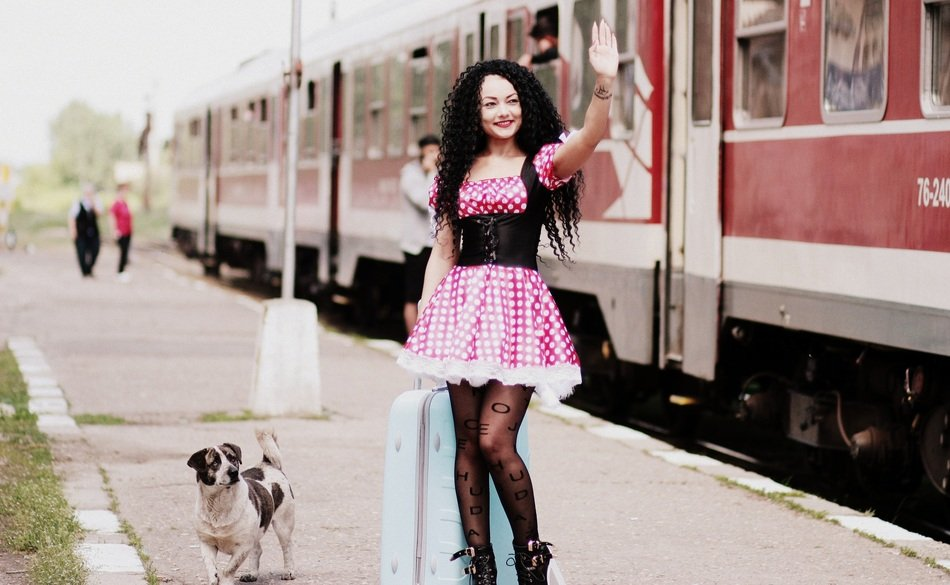 girl in pink dress on the train station