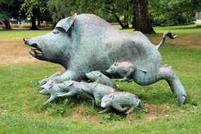 sculpture of a big boar with cubs in the park