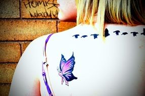 tattoo like a butterfly on the shoulder