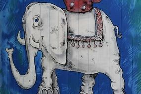 drawing of an elephant on a blue wall