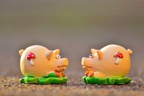 figures of piglets for good luck