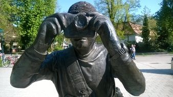 sculpture of a photographer on a sunny day
