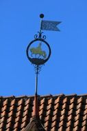 image of a horse on a rooftop weather vane