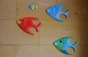 tile decorated by ceramic fishes