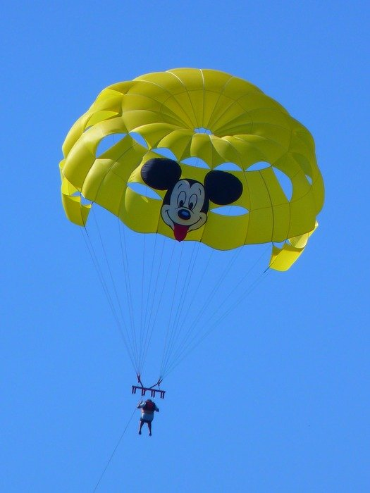 neon yellow parachute with Mickey Mouse