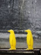 two yellow penguins as an element of decor