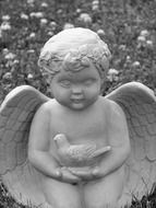 black and white photo of a stone angel statue