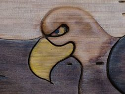 A wooden image of cartoon eagle drawing