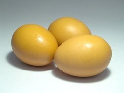 yellow eggs on a white surface