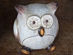 clay sculpture in the shape of an owl
