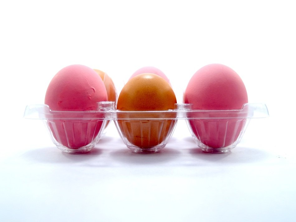 pink and yellow eggs on white background