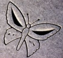 carving in the form of a butterfly on a tombstone
