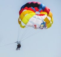 paragliding with colorful parachute