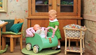 vintage Doll House interior with baby and mother dolls