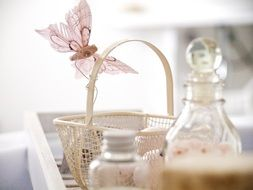wicker basket with a pink butterfly on the table