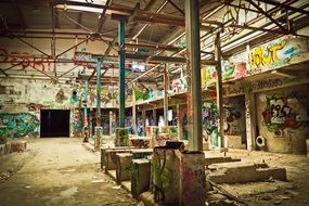 abandoned factory covered with graffiti