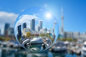 glass ball against the background of the city of toronto