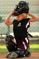 girl in uniform for softball