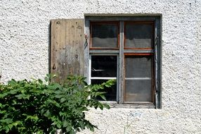 window on the wall with wooden shutters