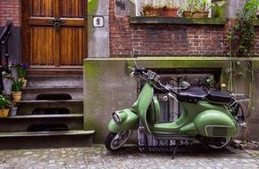 parked green scooter outdoor