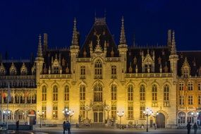 night illumination of the town hall in Bruges, Belgium