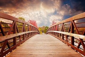 wooden bridge at the sunset