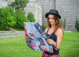 the girl looks at the tourist map