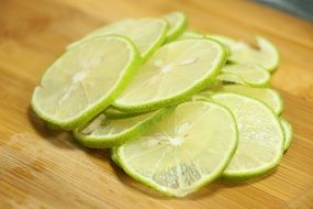 slices of lime on wooden cutboard