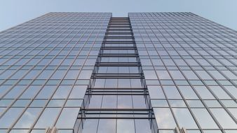 skyscraper in the city center with a glass facade