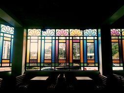 multi-colored stained-glass windows in a restaurant