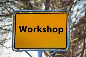 yellow road sign workshop