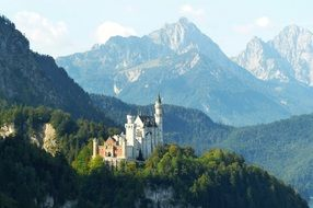 Neuschwanstein Castle in the background of the mountains