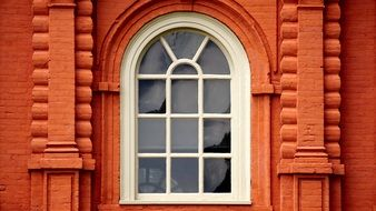 arched Window in red brick wall