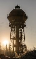 water tower on sunset background
