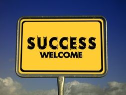 welcome success road sign
