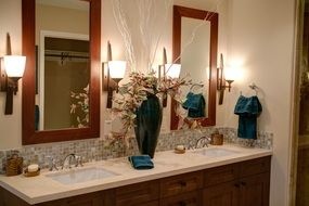 interior of a modern bathroom with two mirrors