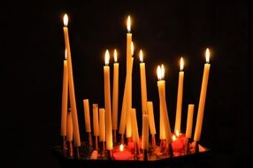 a lot of long candles in church