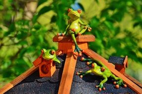 Green frog toys on the home