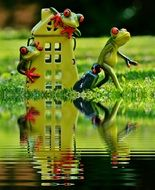 toy house and frogs on the water