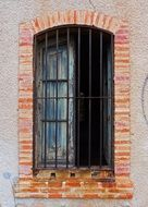 brick window in an abandoned building