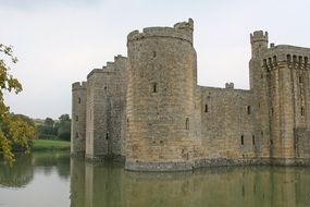 castle stands on the water in england