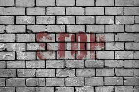 Sign of stop on a wall