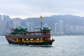pleasure boat on the background of modern architecture in Hong Kong