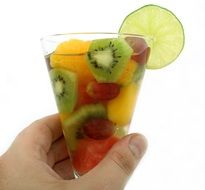 champagne with fruit in a glass