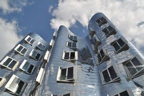 glossy modern building by gehry