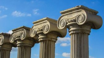 greek columns against blue sky